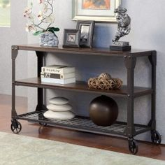 Simple yet beautiful console table crafted from lightweight metal and wood. This vintage design offers sturdy frame with two storage shelves, spacious top, and wheeled construction for added mobility.