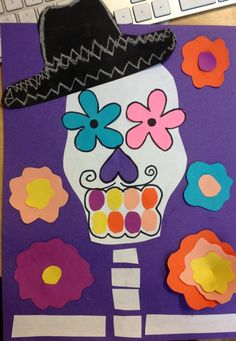 Skeletons and Flowers?  I love this colorful idea for a Halloween project and these would make an eye-catching Halloween bulletin board display.