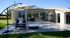 A contemporary lake side home was enhanced with the addition of a generous outside living area - complete with outdoor fire & LouvreTech roofing to sit back and soak up the starlit skies.