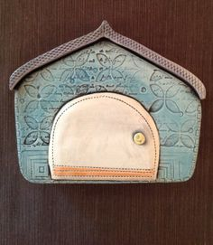 Hey, I found this really awesome Etsy listing at http://www.etsy.com/listing/150717014/blue-ceramic-house-with-white-door-wall