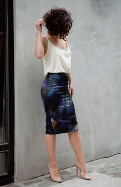 Great example of how to tuck a baggy top into a skirt. Dries Van Noten Painted Floral Skirt with low-back cami by Adriano Goldshmied and Christian Loubitons.