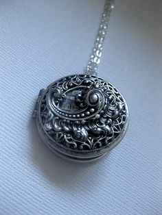 Hey, I found this really awesome Etsy listing at https://www.etsy.com/listing/465038323/fancy-silver-locket-necklace-lace-locket