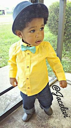 The bowtie is too small for him, but his adorable face and that outfit are just too cute!