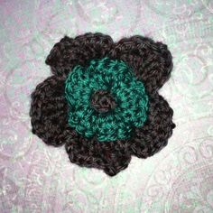 Two tier 3D plum and teal 100% soft acrylic yarn large flower hair clip. Hand wash in lukewarm water only, lay flat till dry, do not bleach and do not iron. $6