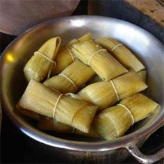 Pamonha is a traditional Brazilian food. It is a paste made from fresh corn and milk, boiled wrapped in corn husks, turned into a dumpling. Variations may include coconut milk. Pamonhas can be savoury or sweet.