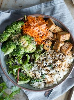 These grain-free, vegan Coconut Cauliflower Rice Buddha Bowl with Tofu and Peanut Sauce are easy to customize, taste amazing and are loaded with nutrition. Vegan Meal Prep, Base Foods, Coconut Cauliflower Rice, Coconut Bowl, Riced Cauliflower, Cauli Rice, Coconut Milk, Rice Recipes, Whole Food Recipes