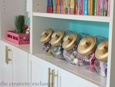 Cookie jars with spray painted lids for organizing for a girl's room. Really cute way of organizing! #cookiejarorgnization #howtoorganizetips #tipsfororganizing