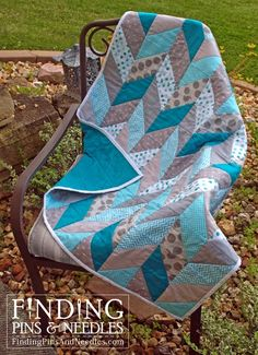 Finding Pins and Needles: Herringbone Baby Quilt. Tutorial for making herringbone/chevron quilt with half square triangles.