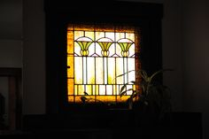 window wall ideas with stained woodwork | This stained glass window (and there's another matching one on the ...