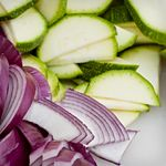 To make dressing, in a large bowl, combine red onion, cilantro, lime juice, olive oil, salt and jalapeño.  Add
