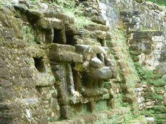 The Jaguar Temple at Lamanai, the jaguar face at the base in profile, Belize