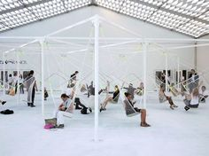 Konstantin Grcic / seats made of netting suspended from a metal structure @ Design Miami/