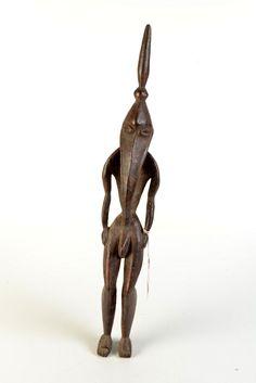 THE SHEILA ROSENBERG COLLECTION A Papua New Guinea male bird head figure, height 58cm.