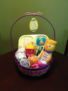 Easter basket for baby gerber cookies squeezable fruit juice i am thinking some sili cups and plates to replace plastic and some snacks easter baby easter gift negle Image collections