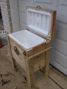 A recycled shipping pallet with an old esky/ drinks cooler installed. Great for outside!