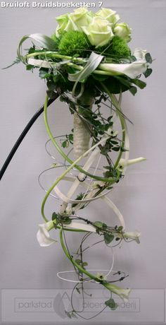 Modern Green and white bouquet with arum/calla lilies. Pinned since I liked the way it cascades in a downward spiral.