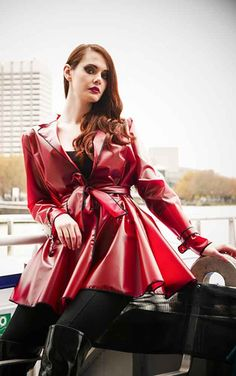 Elements Classic Wrap Red Raincoat    Stunning semi-transparent raincoat from Elements! This lovely blood red raincoat is inspired by classic 50's styles and features a contrasting black trim, storm fla...