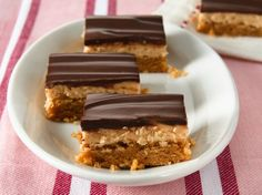 Layers of rich peanut butter cookie, peanut butter filling and chocolate frosting beg to be indulged in.