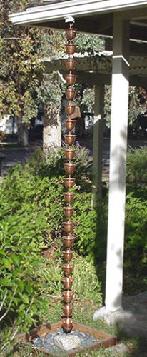Copper Bells Rain Chain hanging from the roof