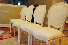 White vinyl Louis dining chairs