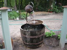 tea pot fountain instructions, home decor, outdoor living, ponds water features, Last year we poured a concrete base that the whiskey barrel sits on so it doesn t sink into the dirt
