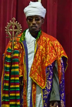 Lalibela priest and the cross of his church, Ethiopia
