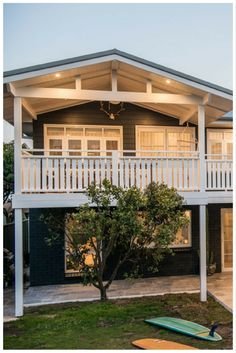 Casement windows, French doors with colonial bars and white trim make Toowoon Bay Reno into a beautiful beach side home.