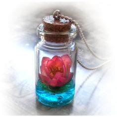 Lotus flower on a magic lake bottle necklace, vial pendant, water... ($36) ❤ liked on Polyvore