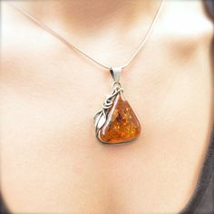 Golden Amber Lily Pendant by VillageSilversmith on Etsy