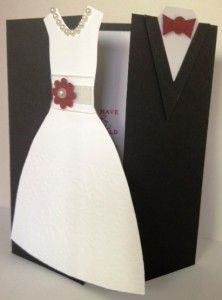 "This card was easier to make than I thought it would be. The dress and tux were cut freehand. Here's a couple of tips: 1) Basic Black Cardstock base is 5 1/4"" x 8 1/2"" and scored at 2 1/8"" on either side. 2) Whisper White Cardstock inside piece is 4"" x 4 7/8"". Supplies Used: Best of Greetings stamp set, Basic Black Cardstock, Whisper White Cardstock, Cherry Cobbler Cardstock, Cherry Cobbler Ink Pad, Boho Blossoms Punch, 5/8"" White Organza Ribbon, Pearl Basic Jewels, Glue Dots"