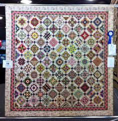 Welcome! This blog is for fans of the 'Nearly Insane' quilt created in the 1870's by Salinda Rupp. If you would like to purchase a copy of the book by Liz Lois with the patterns, check with your local quilt store, or visit the Nearly Insane website.    If you would like to contribute to this blog, leave a comment and we can get back to you with permissions.