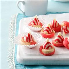 Peppermint Twist Kisses Recipe- Recipes  As rosy as Santa's cheeks, these merry morsels with the chocolate kiss on top are a delightful yuletide favorite and one of my most-requested recipes. —Traci Wynne, Denver, Pennsylvania