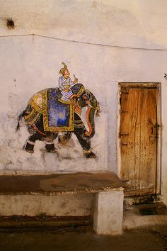 A faded elephant painted onto the wall in a side alley - Udaipur, India. Angus MacRae on flicker