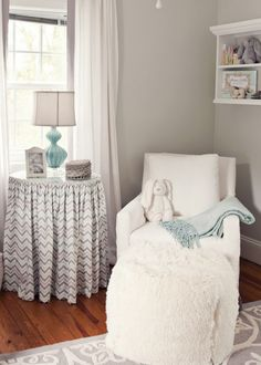 Grey and White Neutral Nursery: would add some yellow and bright blues to keep it neutral