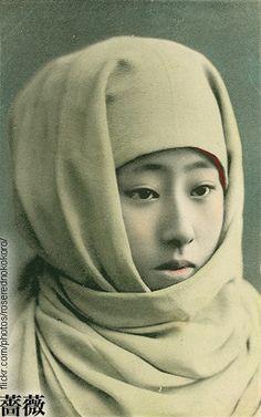Geisha in winter hood. Old Japan.