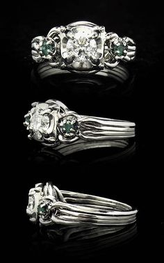 Guinevere Royale Puzzle Ring with Round Diamond and Emeralds