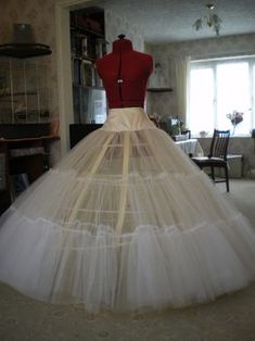 For this costume, you will require intermediate to advanced experience in sewing, with skills for corset making and using a machine ruffeler. All videos for making the complete costume can be found. Tulle Ball Gown, Ball Gowns, Belle Costume, Hoop Skirt, Do It Yourself Fashion, Wedding Dress Patterns, Gown Pattern, Cinderella Dresses, Couture Sewing