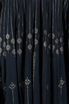 A fine and rare Mariano Fortuny stencilled orientalist black silk evening coat, c. 1910-20