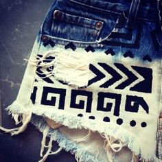 DIY shorts. Bleach bottom and add tribal design
