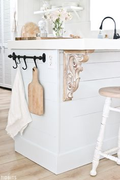 kitchen decor Shiplap kitchen island with elegant wood corbels for Island Bar seating. Ikea towel bar with hooks to hold dish towel and cutting board. Country Kitchen Farmhouse, Farmhouse Kitchen, Kitchen Renovation, Country Kitchen Decor, Bar Seating, Country Kitchen, Kitchen Countertop Organization, Wood Corbels, Shiplap Kitchen
