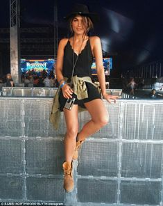 Festival fashion: Bambi Northwood-Blyth wore a little black dress and a pair of Timberland boots on one of the festival days