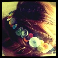 It is so simple to make...measure a piece of elastic around your head..sew it into a headband and then sew on buttons!  Lots of buttons!  It is really easy, and i get tons of compliments every time I wear it. You could even use a headband from the store.  Its perfect with a messy ponytail.