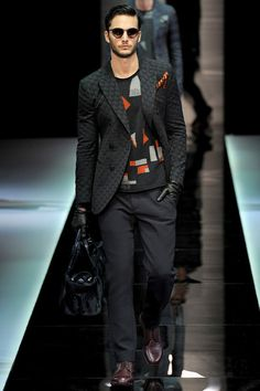 FALL 2013 MENSWEAR Giorgio Armani /  Giorgio Armani often titles his collections with a cryptic little something. His latest, The Men's Project, was one of his most allusive, evoking the quest for an answer to the second most pressing question of our age: What maketh a man? (The first is, of course, What do women want?) The collection offered a 74-outfit treatise on the subject, covering everything from soldier to poet, banker to hoodie, romantic to realist, some of them in the same outfit.