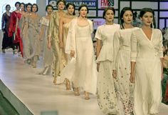 KARACHI: Models walk down on the ramp during Fashion Pakistan Week (FPW) 3 at local hotel.