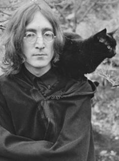 John Lennon with black cat. (The original photo has Yoko Ono at John's side, but this is the one that is usually found on the internet.)