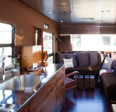 gorgeous kitchen and living space interior of an airstream