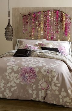 Basic Idea. DIY Headboard: Take a large tree branch, clean and cut off any excess branches.  Then take some Hawaiian leis, cut them in half, and tie to the branch. Can mount onto a pre-painted canvas for contrast or not. Totally doing this!!!!!!!  Would be cool with driftwood and seashells as well!