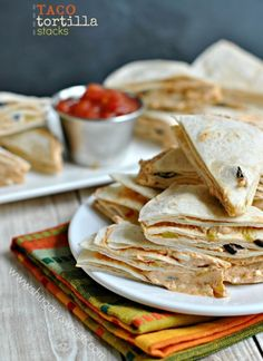 Easy Taco Tortilla Stacks recipe for a quick, delicious snack/appetizer! These go fast in our house!
