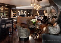 JeffAndrews-Design.com | Warm bar and sitting area with a perfect blend of textiles and chevron wallpaper