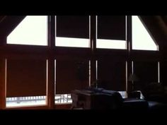 Motorized roller shades installed in Georgian log cabin.